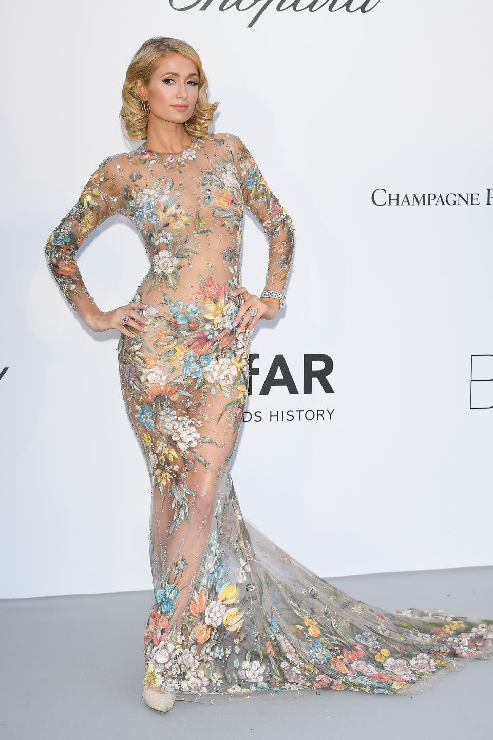 Paris Hilton Shows Up To Cannes in Naked Dress [Video]