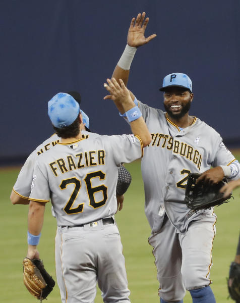 Pittsburgh Pirates second baseman Adam Frazier (26) and right fielder Gregory Polanco celebrate after they defeated the Miami Marlins in a baseball game, Sunday, June 16, 2019, in Miami. (AP Photo/Wilfredo Lee)