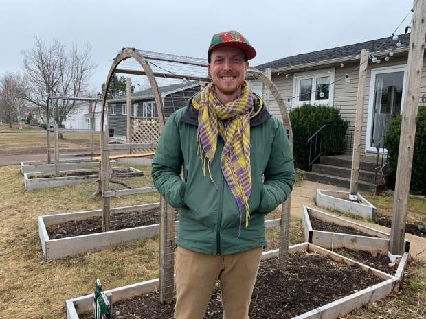 Sylvain Ward says the City of Moncton is moving in the right direction by introducing changes to its definition of landscaping. He's ready to start planting his front yard garden. (Kate Letterick/CBC News - image credit)