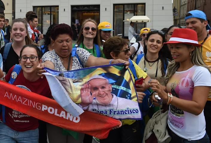 Young Catholics from around the world gather at the market square in Krakow, Poland, on July 25, 2016, before the opening of World Youth Day (AFP Photo/Janek Skarzynski)