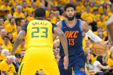 Apr 27, 2018; Salt Lake City, UT, USA; Oklahoma City Thunder forward Paul George (13) dribbles the ball against Utah Jazz forward Royce O'Neale (23) during the first half of game six of the first round of the 2018 NBA Playoffs at Vivint Smart Home Arena. Mandatory Credit: Russ Isabella-USA TODAY Sports