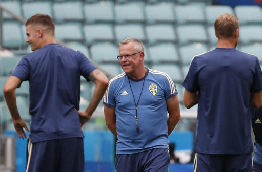 Sweden head coach Janne Andersson, center, stands with players at the start of a training session on the eve of their Group F match against Germany, during the 2018 soccer World Cup in Sochi, Russia, Friday, June 22, 2018. (AP Photo/Rebecca Blackwell)