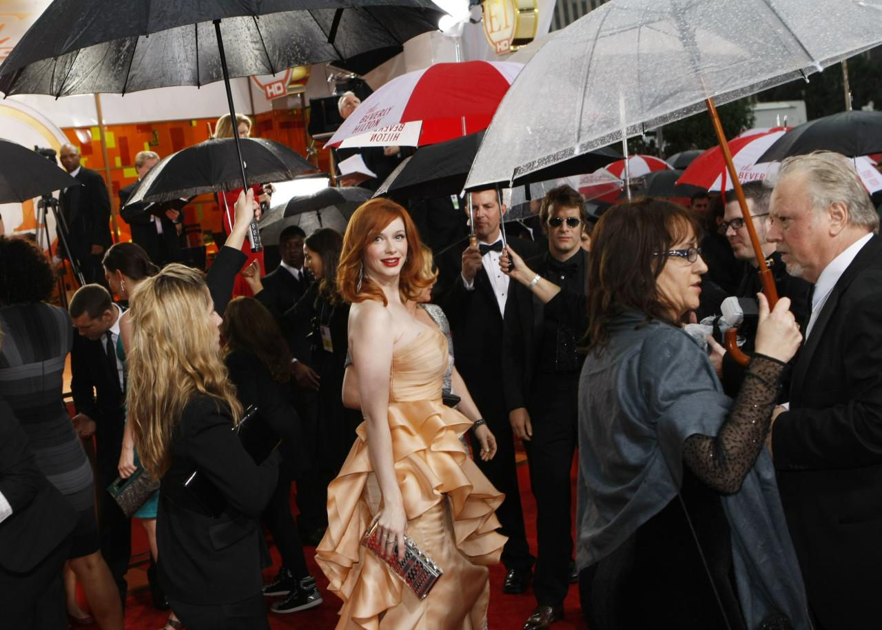 In 2010, it was raining on the red carpet, which meant that celebs like <em>Mad Men</em>'s Christina Hendricks had to look chic while seeking cover under umbrellas.