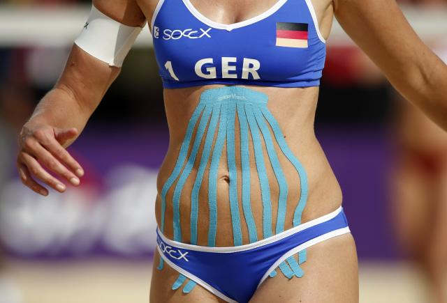 Olympic athletes clearly can't get enough of Kinesio tape, but does it really make a difference? Regardless, Katrin Holtwick definitely wins the gold medal for most creative application. (Photo: REUTERS/Marcelo Del Pozo