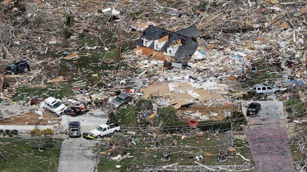 PHOTO: Debris from storm shattered homes are scattered on the ground near Cookeville, Tenn., March 3, 2020. Deadly tornadoes ripped across the state early Tuesday. (Mark Humphrey/AP)
