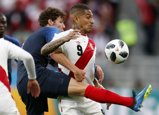 Peru's Pablo Guerrero, right, is challenged by France's Benjamin Pavard during the group C match between France and Peru at the 2018 soccer World Cup in the Yekaterinburg Arena in Yekaterinburg, Russia, Thursday, June 21, 2018. (AP Photo/Natacha Pisarenko)