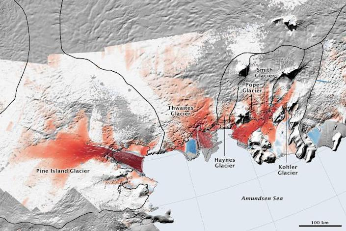 In West Antarctica, the Pine Island Glacier and Thwaites Glacier are becoming more unstable, shedding more ice to the sea, indicated in red. / Credit: NASA