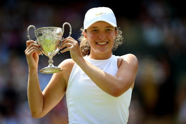 Iga Swiatek with the girls' singles trophy at Wimbledon two years ago