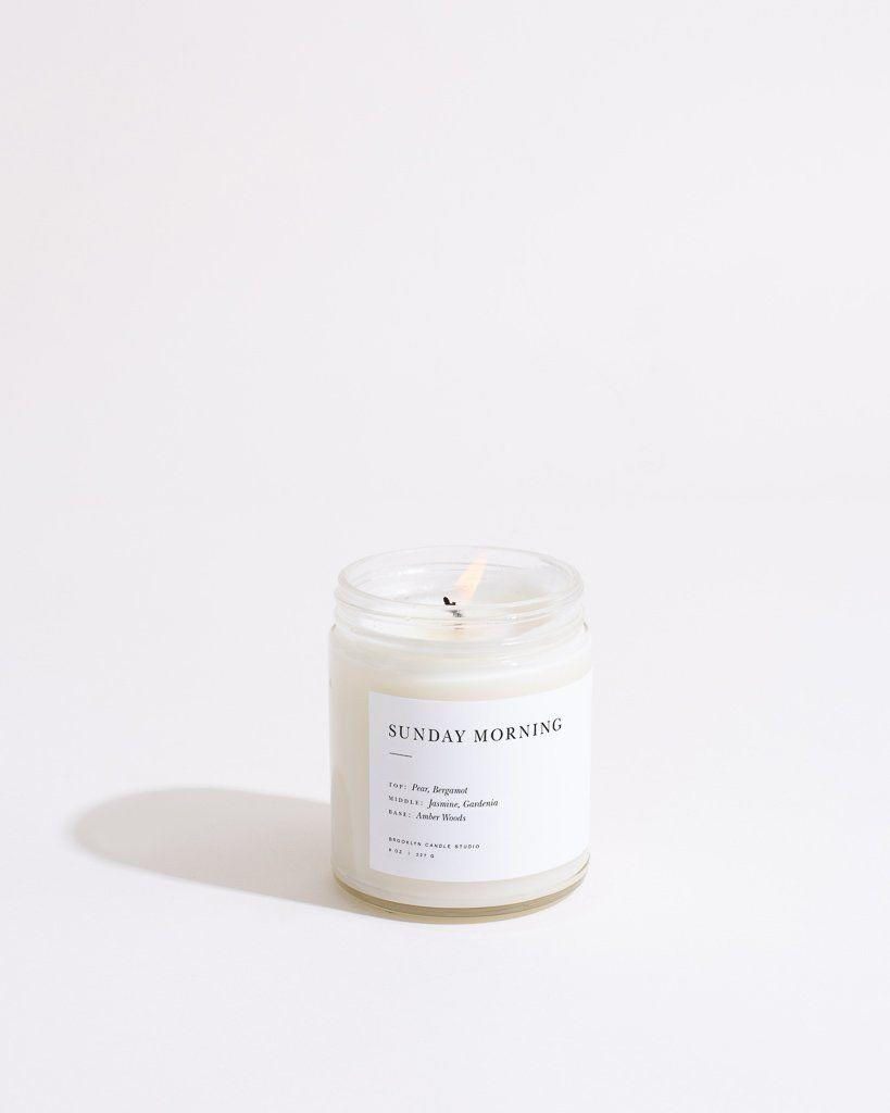 """<p><strong>Brooklyn Candle Studio</strong></p><p>brooklyncandlestudio.com</p><p><strong>$28.00</strong></p><p><a href=""""https://go.redirectingat.com?id=74968X1596630&url=https%3A%2F%2Fbrooklyncandlestudio.com%2Fproducts%2Fsunday-morning-minimalist-candle-1&sref=https%3A%2F%2Fwww.goodhousekeeping.com%2Flife%2Fentertainment%2Fg34862781%2Fbest-scented-candles%2F"""" rel=""""nofollow noopener"""" target=""""_blank"""" data-ylk=""""slk:Shop Now"""" class=""""link rapid-noclick-resp"""">Shop Now</a></p><p>A smell combination that's easy like Sunday morning: pear, bergamot, amber, and pear. </p>"""
