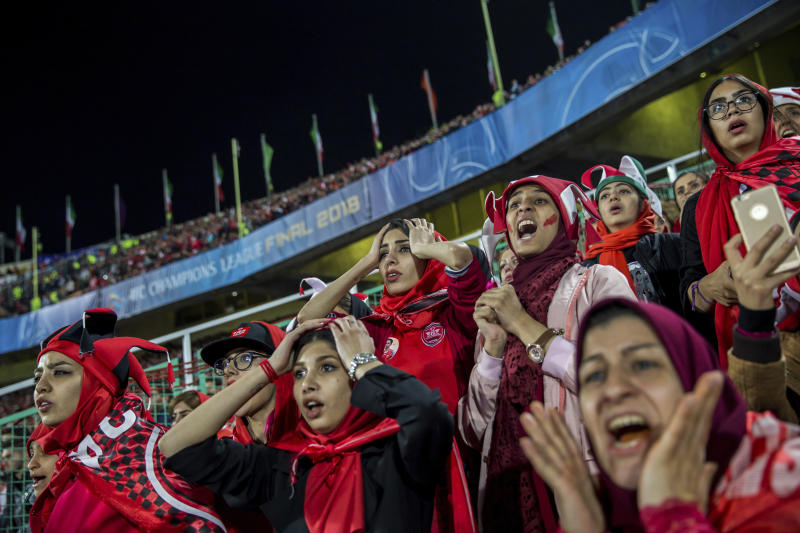 "In this image released by the World Press Photo Foundation Thursday April 11, 2019, titled ""Crying for Freedom"" by Forough Alaei which was awarded first prize in the Sports, Stories, category shows women following the AFC Champions League Cup match between Iran's Persepolis and Japan's Kashima Antlers from a segregated section of a stand at the Azadi Stadium, Tehran, 10 November 2018. (Forough Alaei, World Press Photo via AP)"