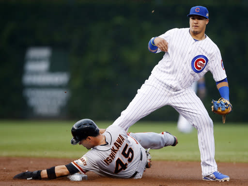 San Francisco Giants' Travis Ishikawa (45) is forced out by Chicago Cubs shortstop Javier Baez on a single hit by Angel Pagan during the seventh inning of thecontinuationof arain-suspended baseballgame that beganTuesday, on Thursday, Aug. 21, 2014, in Chicago. (AP Photo/Andrew A. Nelles)