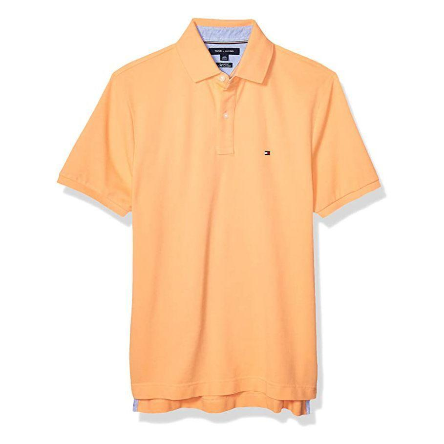 """<p><strong>Tommy Hilfiger</strong></p><p>amazon.com</p><p><strong>$32.26</strong></p><p><a href=""""https://www.amazon.com/dp/B07XPDTDS9?tag=syn-yahoo-20&ascsubtag=%5Bartid%7C2139.g.36687307%5Bsrc%7Cyahoo-us"""" rel=""""nofollow noopener"""" target=""""_blank"""" data-ylk=""""slk:BUY IT HERE"""" class=""""link rapid-noclick-resp"""">BUY IT HERE</a></p><p>Brighten up your wardrobe with this melon-hued <a href=""""https://www.menshealth.com/style/g19519678/best-polos-for-bar-or-beach/"""" rel=""""nofollow noopener"""" target=""""_blank"""" data-ylk=""""slk:polo"""" class=""""link rapid-noclick-resp"""">polo</a>, which is perfect for Saturday brunch with the family. Dress it up or down—there's no going wrong here.</p>"""