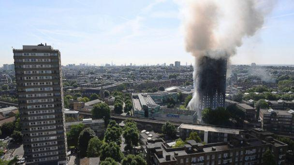 PHOTO: Smoke billows from a fire that has engulfed the 24-story Grenfell Tower in west London, June 14, 2017. (Victoria Jones/PA via AP Photo)