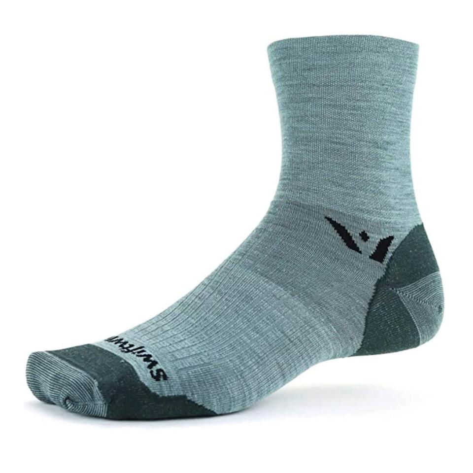 """<p><strong>Swiftwick</strong></p><p>amazon.com</p><p><strong>$19.99</strong></p><p><a href=""""https://www.amazon.com/dp/B08DYCDPMM?tag=syn-yahoo-20&ascsubtag=%5Bartid%7C2142.g.36448024%5Bsrc%7Cyahoo-us"""" rel=""""nofollow noopener"""" target=""""_blank"""" data-ylk=""""slk:Shop Now"""" class=""""link rapid-noclick-resp"""">Shop Now</a></p><p>The natural merino wool material of these socks actively works to move moisture away from your feet thus keeping them dry, odorless, and blister-free.</p>"""