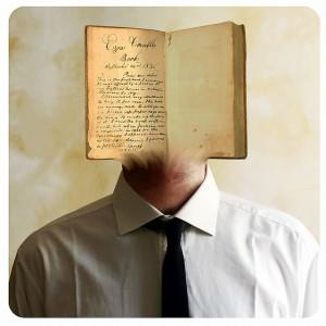 Man with book for a face