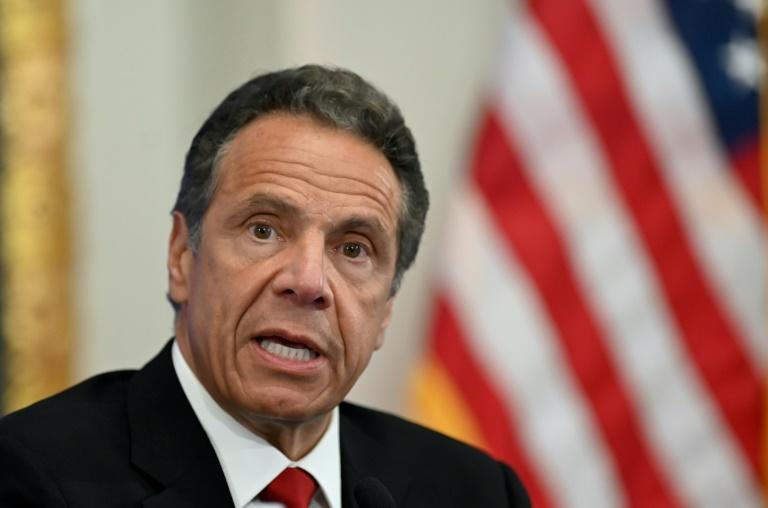 New York governor Andrew Cuomo (pictured May 2020) has said the travel advisory is aimed at keeping infection and hospitalization rates in the New York area low as the region slowly re-opens businesses and activities