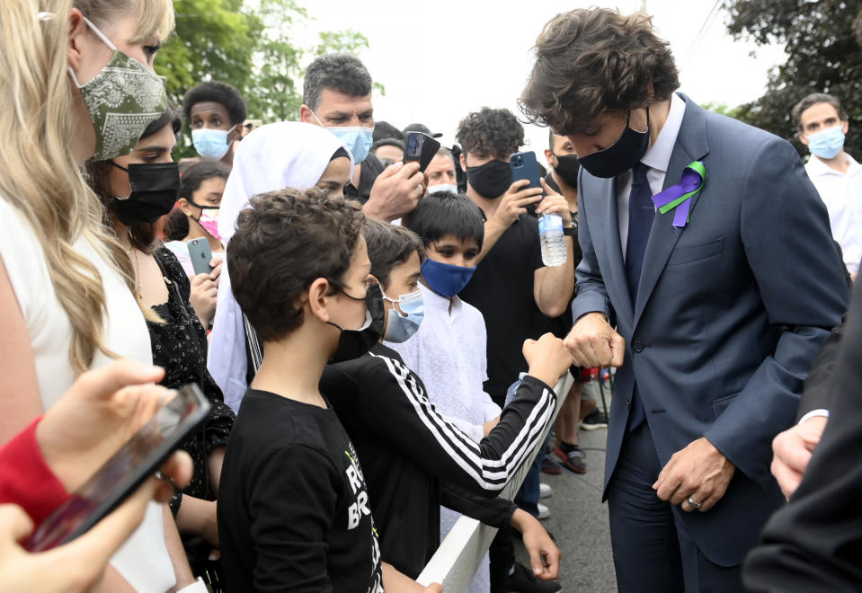 <p>Prime Minister Justin Trudeau greets mourners at a vigil for the victims of the deadly vehicle attack on five members of the Canadian Muslim community in London, Ont., on Tuesday, June 8, 2021. Four of the members of the family died and one is in critical condition. Police have charged a London man with four counts of murder and one count of attempted murder. THE CANADIAN PRESS/Nathan Denette</p>