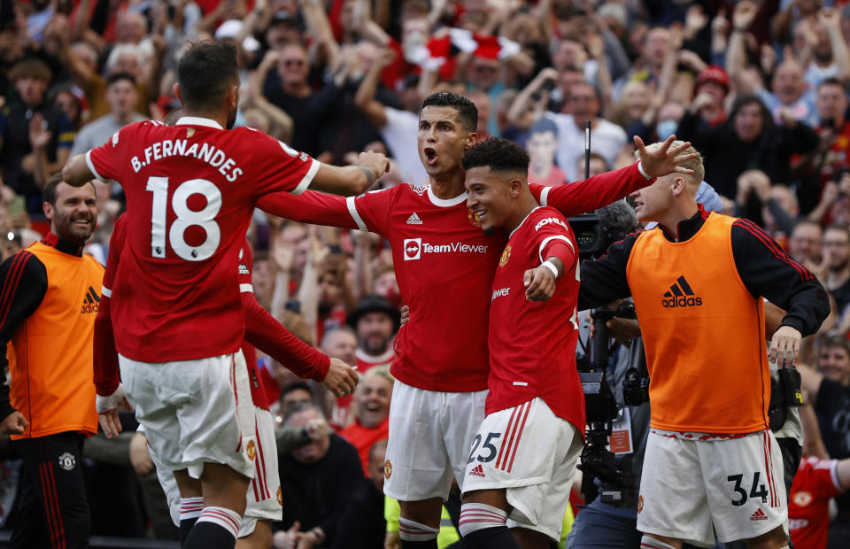 Manchester United's Cristiano Ronaldo celebrates scoring their second goal with his new teammates.