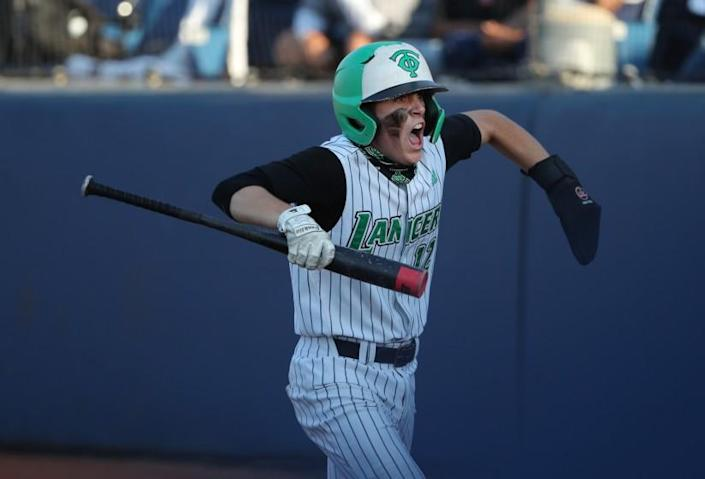 FULLERTON, CA - JUNE 19, 2021: Thousand Oaks Peyton Miller (12) reacts after scoring the tying run against Trabuco Hills in the fifth inning of the CIF Southern Section Division 2 Championship at Cal State Fullerton on June 19, 2021 in Fullerton, California. Thousand Oaks won 3-2.(Gina Ferazzi / Los Angeles Times)
