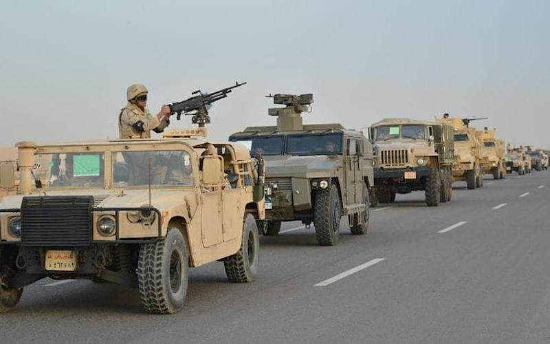 Egyptian Army's Armoured Vehicles are seen on a highway to North Sinai during a launch of a major assault against militants, in Ismailia - REUTERS