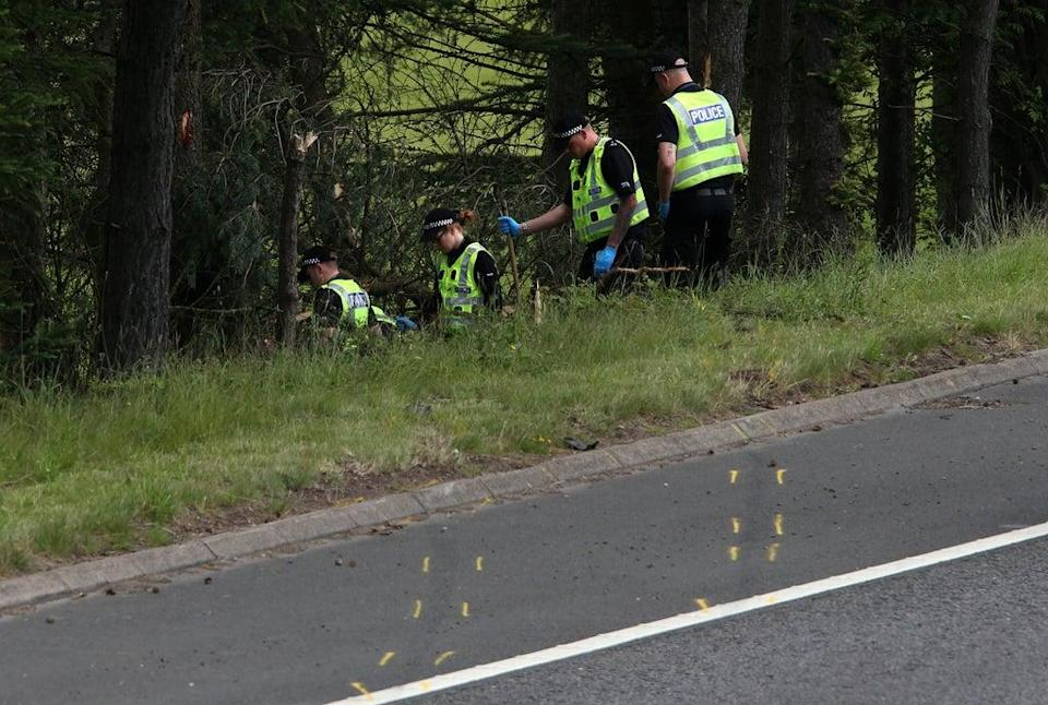 Police officers at the site of the crash on the M9 near Stirling (Andrew Milligan/PA) (PA Wire)
