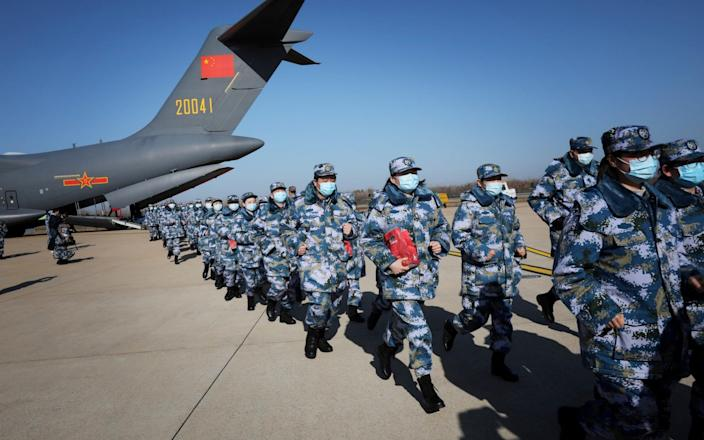 Medical personnel arrive in transport aircraft of the Chinese People's Liberation Army (PLA) Air Force at the Wuhan Tianhe International Airport following the outbreak of Covid-19 in Wuhan, Hubei province, China February 17, 2020.  - China Daily CDIC/REUTERS