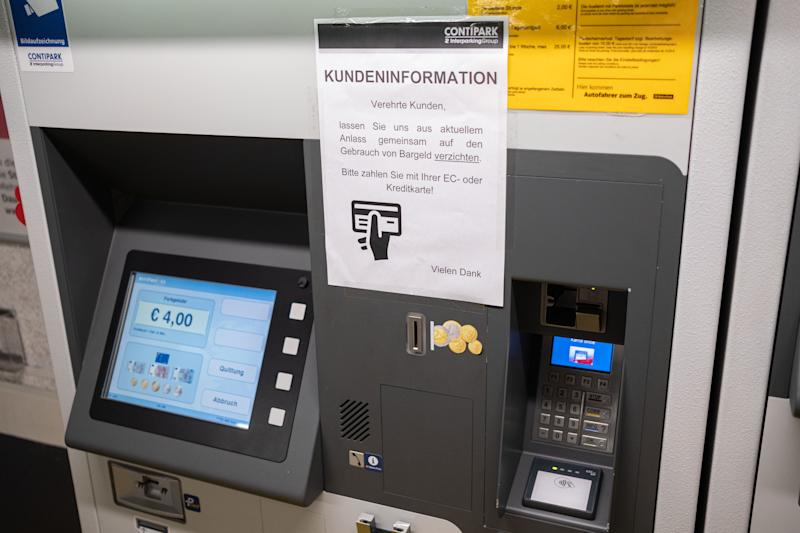 17 March 2020, Lower Saxony, Hanover: A customer information for current reasons to pay with EC or credit card instead of cash is displayed at a parking fee machine in Hanover. Photo: Peter Steffen/dpa (Photo by Peter Steffen/picture alliance via Getty Images)