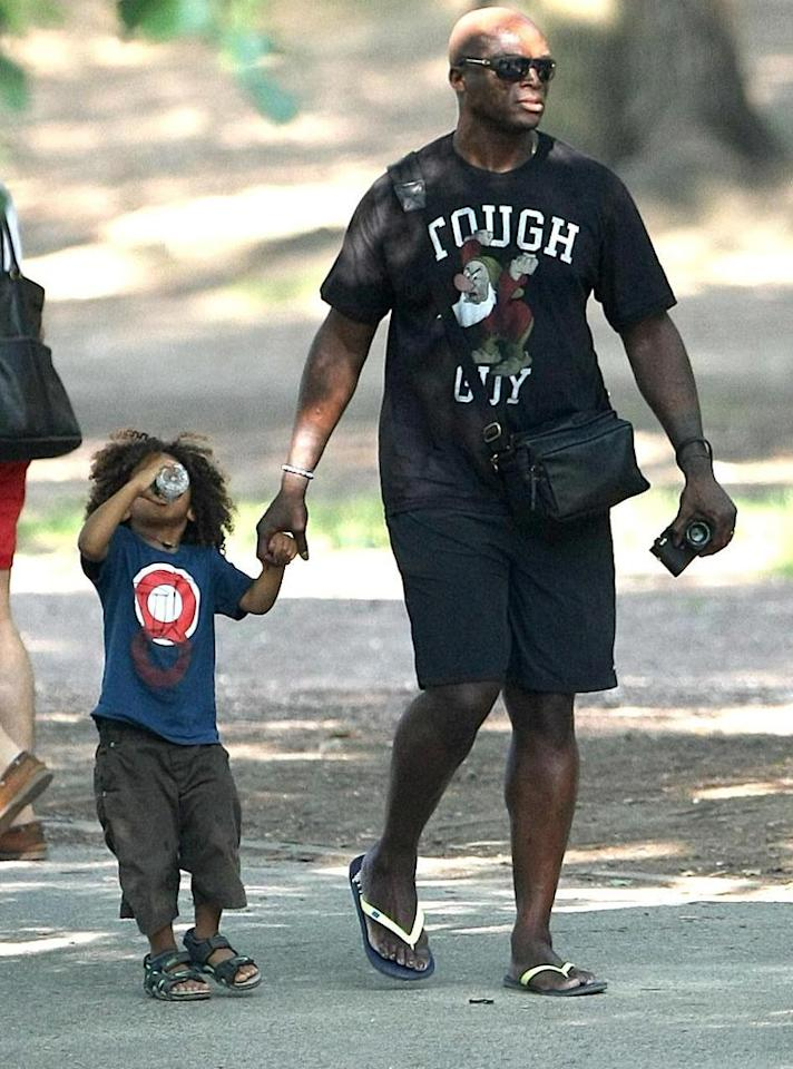"Meanwhile, Seal and wife Heidi Klum led their four children on an adventure through NYC's Central Park. Looks like little Johan, 3, worked up a thirst! Daniel/<a href=""http://www.infdaily.com"" target=""new"">INFDaily.com</a> - June 20, 2010"