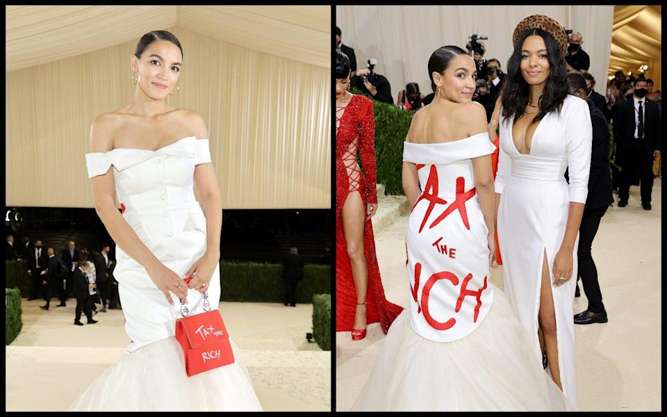 Alexandria Ocasio-Cortez with Brother Vellies' Aurora James who designed her 'Tax the Rich' gown - Jamie McCarthy and Arturo Holmes / Getty Images