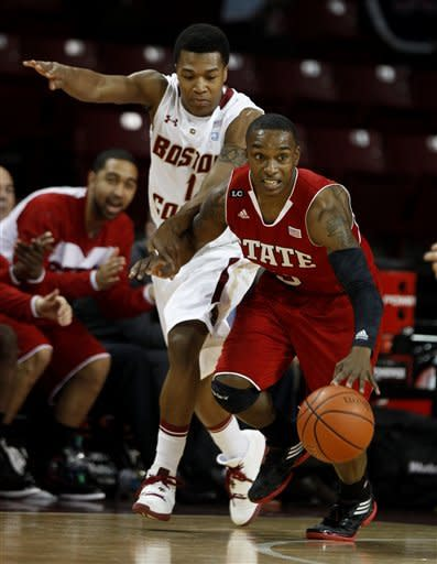 North Carolina State's Alex Johnson, right, brings the ball upcourt after stealing it, past Boston College's Gabe Moton (1), during the first half of an NCAA college basketball game Wednesday, Feb. 1, 2012, in Boston. (AP Photo/The News & Observer, Ethan Hyman) MANDATORY CREDIT