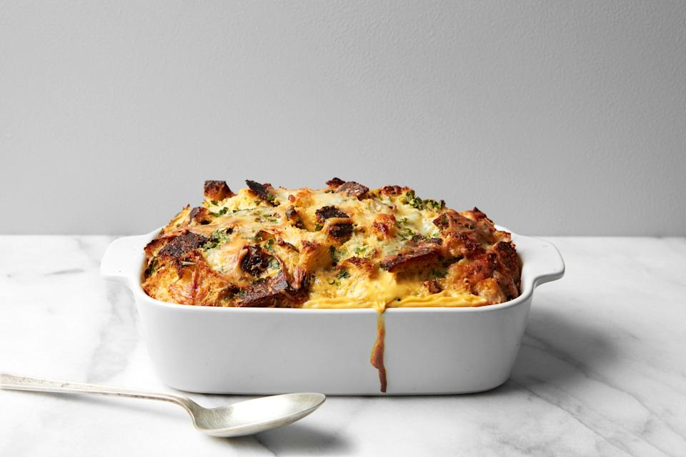 """Here's the perfect make-ahead brunch dish, a fantastic French onion dip meets savory bread pudding situation. The secret ingredient: <a href=""""https://www.epicurious.com/ingredients/heidi-swanson-diy-onion-dip-mix-lipton-could-never-article?mbid=synd_yahoo_rss"""" rel=""""nofollow noopener"""" target=""""_blank"""" data-ylk=""""slk:DIY onion soup mix"""" class=""""link rapid-noclick-resp"""">DIY onion soup mix</a>. <a href=""""https://www.epicurious.com/recipes/food/views/french-onion-breakfast-strata-super-natural-simple-heidi-swanson?mbid=synd_yahoo_rss"""" rel=""""nofollow noopener"""" target=""""_blank"""" data-ylk=""""slk:See recipe."""" class=""""link rapid-noclick-resp"""">See recipe.</a>"""