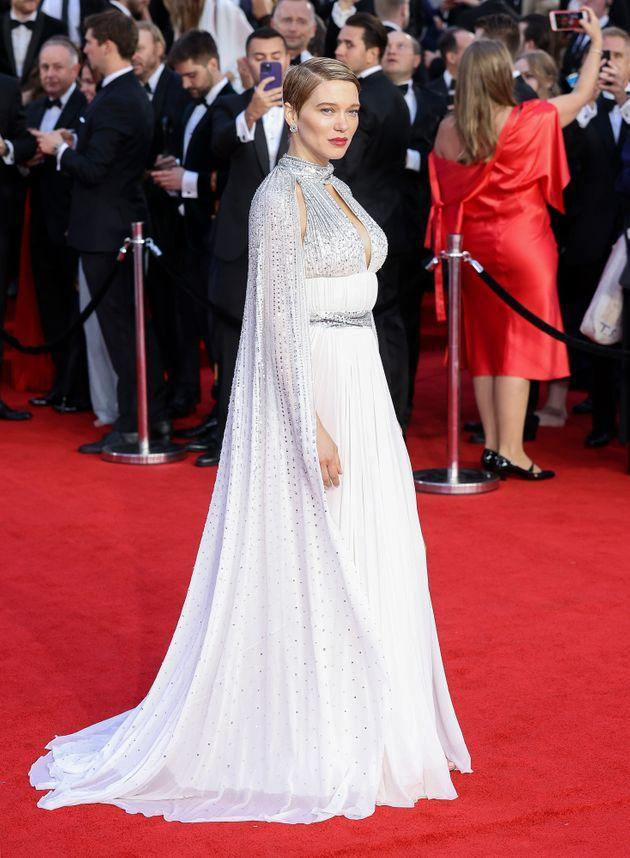 Léa Seydoux in a caped white dress with silver detailing. (Photo: Mike Marsland via Getty Images)