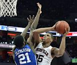 Louisville's Wayne Blackshear, right, attempts a shot over the defense of Duke's Amile Jefferson during the second half of an NCAA college basketball game, Saturday, Jan. 17, 2015, in Louisville, Ky. Duke won 63-52. (AP Photo/Timothy D. Easley)