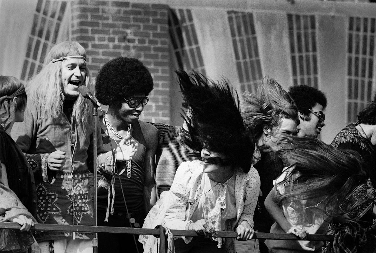 "<p>The cast of the rock musical ""Hair"" during a free performance in New York's Central Park to mark the one year anniversary of its Broadway debut on April 27, 1969. The musical celebrated hippies living in the Age of Aquarius and several of its songs became anti-Vietnam War anthems. (Photo: ""New York City Up and Down"" by Jean-Pierre Laffont, copyright © 2017, published by Glitterati Inc. <a rel=""nofollow"" href=""https://glitteratiincorporated.com"">https://glitteratiincorporated.com</a>) </p>"