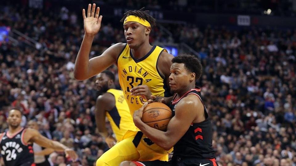 Myles Turner guards Kyle Lowry in transition