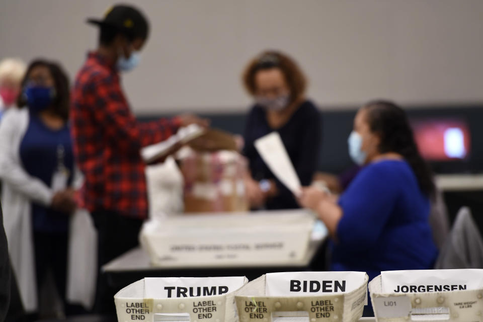 FILE - In this Nov. 13, 2020, file photo Cobb County election officials sort ballots during an audit in Marietta, Ga. (AP Photo/Mike Stewart, File)