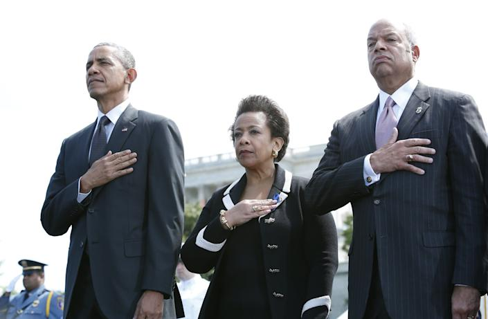 President Barack Obama (from left), Attorney General Loretta Lynch and Department of Homeland Security Secretary Jeh Johnson attend the 34rd Annual National Peace Officers' Memorial Service on Capitol Hill on May 15, 2015.
