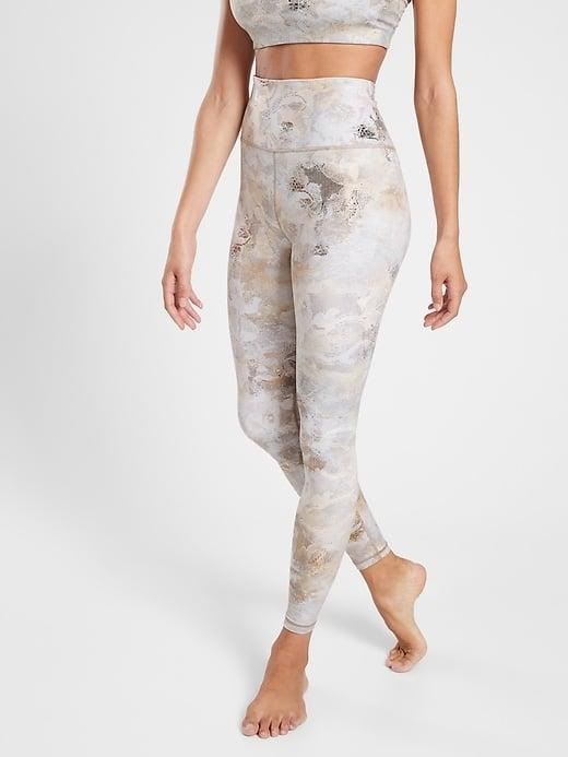 <p>Stay gold (and tucked in) while wearing the <span>Athleta Elation Ultra High Rise Gilded Tight</span> ($80, originally $98) during Pilates and barre.</p>