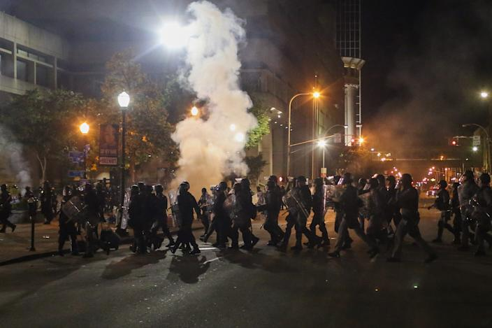 """Riot police clear protesters from Louisville's' Jefferson Square Park. <p class=""""copyright"""">Daniel Shular</p>"""