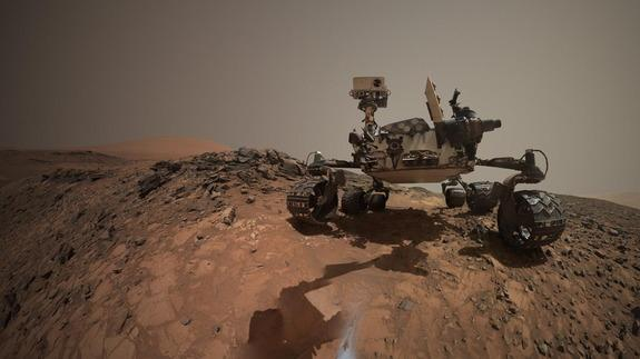 """NASA's Curiosity Mars rover drilled into a rock target called """"Buckskin"""" on lower Mount Sharp as seen in a self-portrait which combined several images taken by Curiosity's Mars Hand Lens Imager (MAHLI) on Aug. 5, 2015. Image released Aug. 19, 2"""