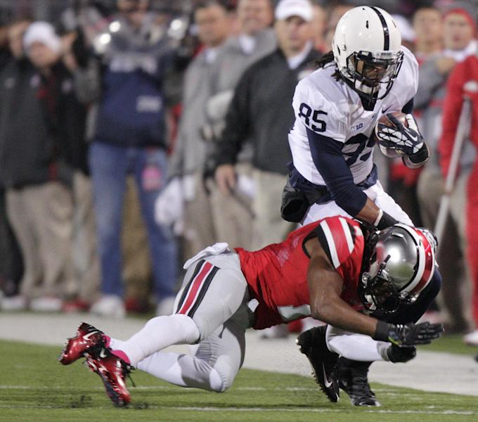 Penn State wide receiver Brandon Felder, right, is tackled by Ohio State cornerback Bradley Roby during the first quarter of an NCAA college football game Saturday, Oct. 26, 2013, in Columbus, Ohio. (AP Photo/Jay LaPrete)