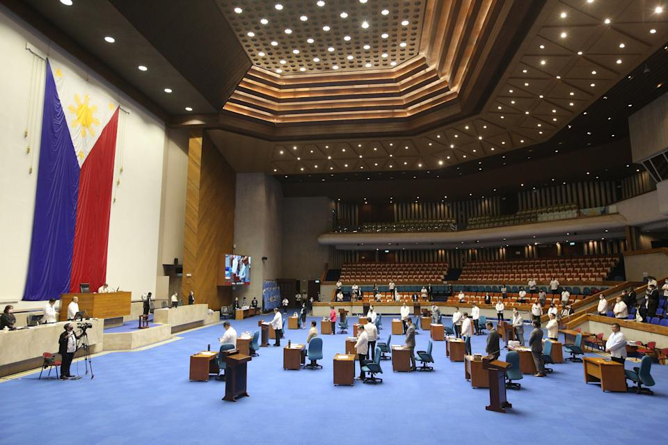 FILE PHOTO: Members of the Lower House of Congress attend a special session with desks arranged to observe social distancing amongst members in Manila on March 23, 2020, to discuss a proposed emergency power to be given to President Rodrigo Duterte to tackle the COVID-19 coronavirus outbreak. (Photo: STR/AFP via Getty Images)