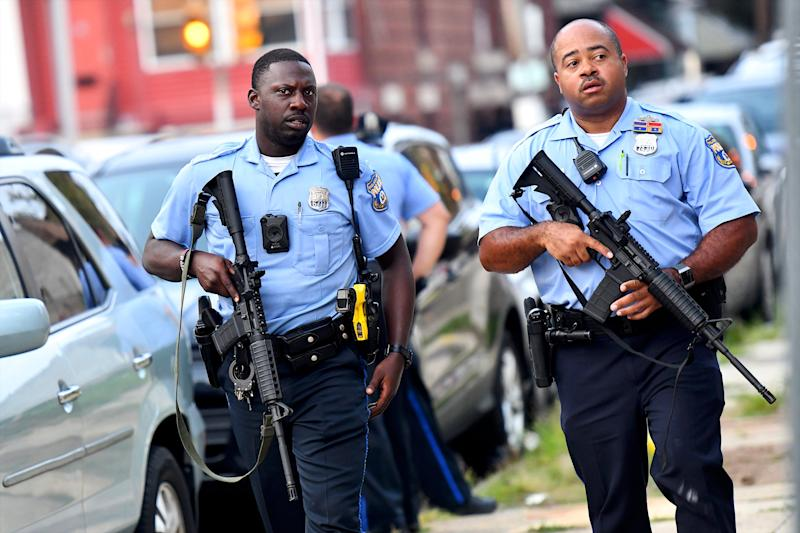 Police officers carrying assault rifles respond to a shooting on August 14, 2019 in Philadelphia, which has registered its highest number of homicides to date since 2007.
