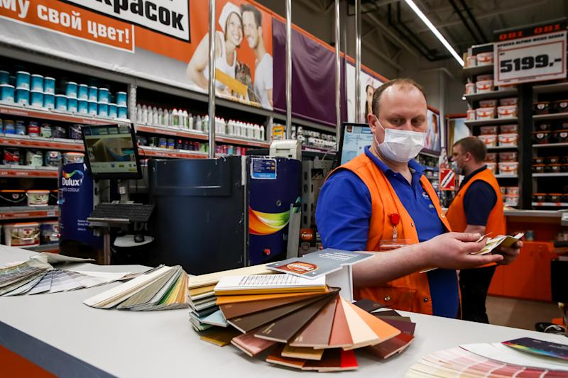 MOSCOW, RUSSIA - MARCH 25, 2020: Workers in face masks in an OBI hypermarket during the pandemic of the novel coronavirus (COVID-19). As of 25 March 2020, Russia has confirmed more than 600 cases of the novel coronavirus, with more than 400 cases in Moscow. Sergei Fadeichev/TASS (Photo by Sergei Fadeichev\TASS via Getty Images)