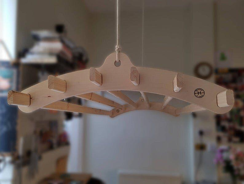 """Use it as a clothes drying rack for high ceilings. It can also be used as a pot rack in kitchens. <strong><a href=""""https://fave.co/2XceDG4"""" target=""""_blank"""" rel=""""noopener noreferrer"""">Get it on Etsy, $150+</a></strong>.&nbsp;"""