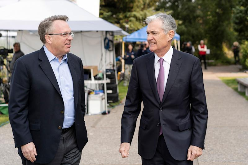 John Williams, left, President and CEO of the Federal Reserve Bank of New York, left, and Jerome Powell, Chairman of the Board of Governors of the Federal Reserve System, right, walk together after Powell's speech at the Jackson Hole Economic Policy Symposium on Friday, Aug. 24, 2018 in Jackson Hole, Wyo. Federal Reserve Chairman Jerome Powell signaled Friday that he expects the Fed to continue gradually raising interest rates if the U.S. economic expansion remains strong. (AP Photo/Jonathan Crosby)