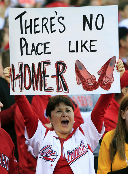 A Cincinnati Reds fan holds a sign supporting starting pitcher Homer Bailey prior to Game 3 of the National League division baseball series against the San Francisco Giants, Tuesday, Oct. 9, 2012, in Cincinnati. (AP Photo/Al Behrman)