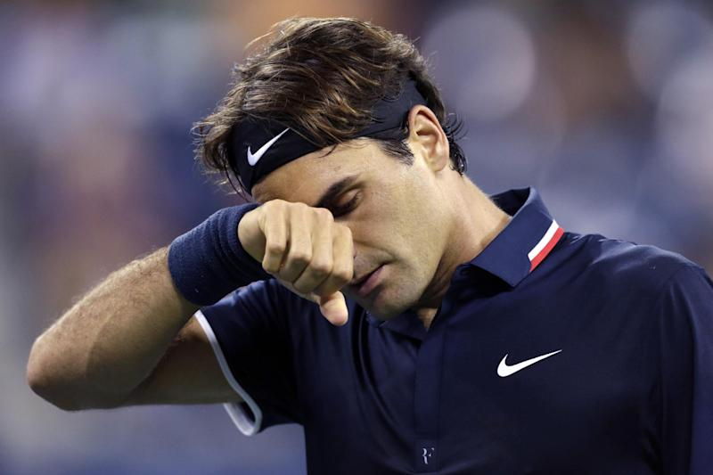 Roger Federer, of Switzerland, wipes his brow late in the fourth set during his loss to Tomas Berdych, of the Czech Republic, in the quarterfinal round of play at the U.S. Open tennis tournament, Wednesday, Sept. 5, 2012, in New York. Berdych won 7-6 (1), 6-4, 3-6, 6-3. (AP Photo/Charles Krupa)