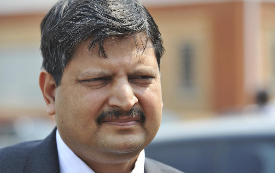 FILE - In this Sept. 2010 file photo, Atul Gupta, of the Gupta family, is seen outside magistrates courts in Johannesburg. South Africa said Friday, June 11, 2021 it has finalized an extradition treaty with United Arab Emirates that would allow it to bring back members of the Indian family accused of involvement in high-level state corruption to face trial. (AP Photo/South Africa Out)