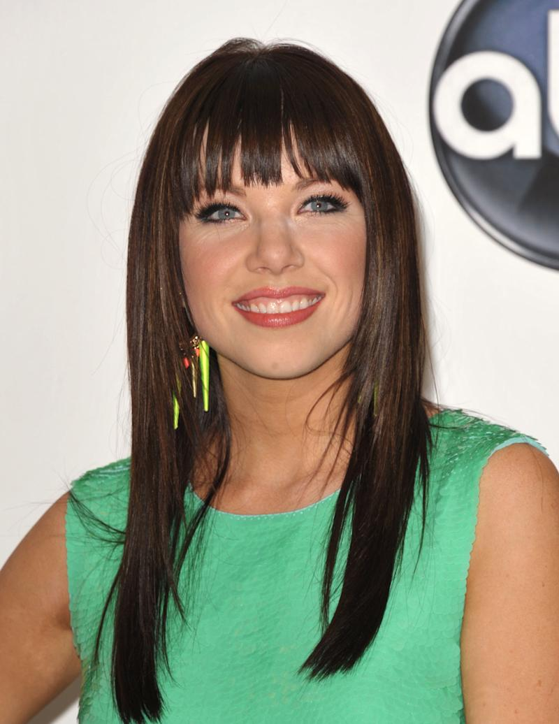 "FILE - In this May 20, 2012 file photo, singer Carly Rae Jepsen poses for a photo in the media room at the 2012 Billboard Awards at the MGM Grand in Las Vegas. For those predicting that Jepsen might be headed to one-hit wonder-dom, take note _ she's already got another song climbing the charts, ""Good Time,"" with Owl City. Still, it's her ubiquitous ""Call Me Maybe"" that has shot her to stardom and taken the world by storm. The song has been No. 1 on Billboard's Hot 100 chart for the last five weeks, and parodies of the song from the likes of Justin Bieber and boy band Big Time Rush to James Franco and even Cookie Monster have popped up online and on late night talk shows. (Photo by John Shearer/Invision/AP, File)"